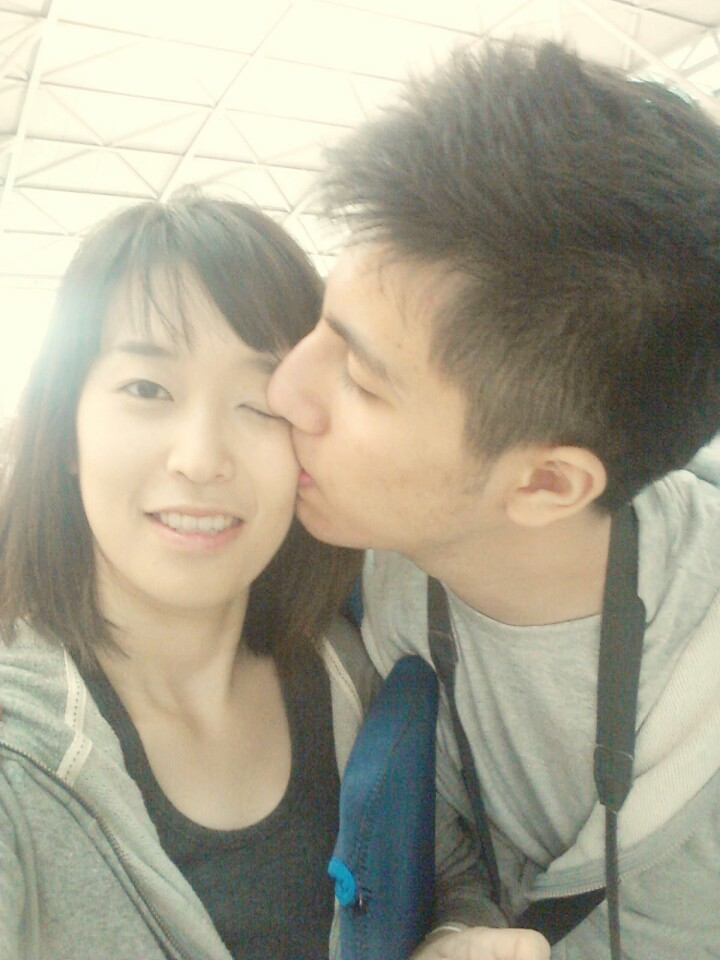 At the airport with my girlfriend. A big kiss before I leave her to go to my fight.